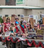 Girl scouts on a truck in a parade. royalty free stock images