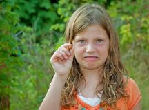 Girl Scowling At Rotton Raspberry Royalty Free Stock Image