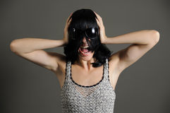 Girl screaming. Portrait of young woman screaming with annoyed expression Stock Photos