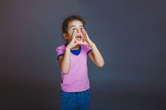 Girl screaming away on gray background Royalty Free Stock Images