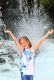 Girl screaming with delight by fountain Stock Photos