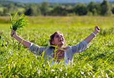 Girl screaming in the grass Stock Photos