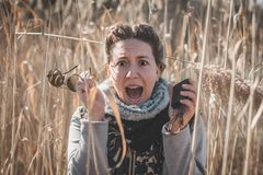 Girl is screaming because she is lost. Compass for better orientation in the nature. Girl is lost in the wild with compass and sunglasses royalty free stock images