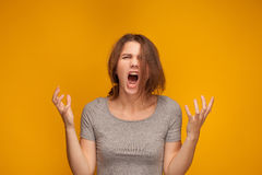Girl is screaming loud. Girl is screaming very loud. She is angry Stock Images