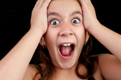 Girl screaming loudly on a black background Royalty Free Stock Images