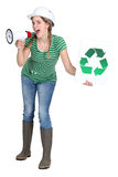 Girl screaming into megaphone. Girl screaming in megaphone with symbol for recycling on a sign Royalty Free Stock Image