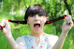 Girl screaming in nature stock photo