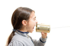 Girl screaming in the phone built with the jar. Girl screaming in the phone built with the tin jar Royalty Free Stock Images