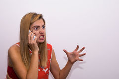 Girl screaming on the phone Stock Photo