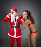 Girl screaming on santa claus ears Stock Photos