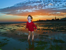 Girl screaming. In the sunset Royalty Free Stock Photo