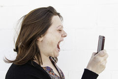 Girl screaming to mobile Stock Image