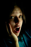 Girl screams in fright Stock Image
