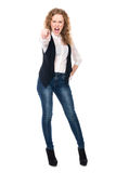 Girl screams and points his finger at the camera. Royalty Free Stock Images