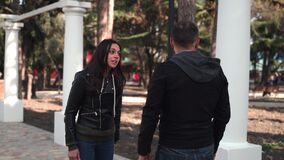 The girl screams strongly at the guy and quarrels with him
