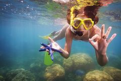 Girl in scuba mask holding starfish Stock Photos