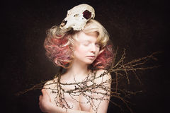 Girl with scull and tree branches Royalty Free Stock Photography