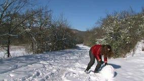Girl Sculpt Snowman stock video footage