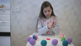 Girl sculpts clay figure flower stock video footage