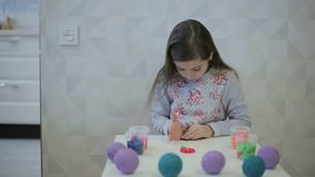 Girl sculpts clay figure flower stock footage