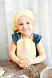 Girl sculpts dough rolls Stock Photo