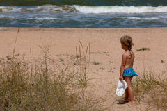 Girl and sea Stock Images