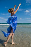 The girl and the sea. The girl in a bathing suit looks in the sky on the bank of the Mediterranean sea Stock Photo
