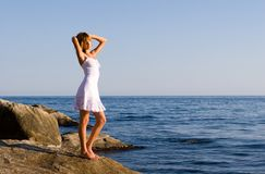 Girl and sea. The girl costs(stands) on a stone at the sea Royalty Free Stock Photos