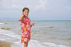 Girl and the sea. Stock Photo