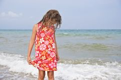 Girl and the sea. Stock Photos