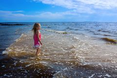 Girl and the sea. Royalty Free Stock Image