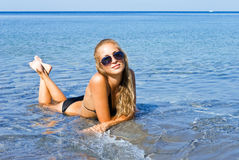 The girl and the sea. Girl on the beach on a sunny day Stock Photo
