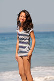 Girl by the sea. Asian girl standing by the ocean Stock Photography