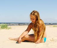 Girl at the sea. Stock Photos