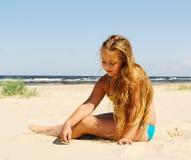 Girl at the sea. Stock Photos