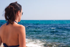 Girl and sea. Young woman looking at the sea Stock Photography