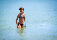 Girl in the sea Stock Images