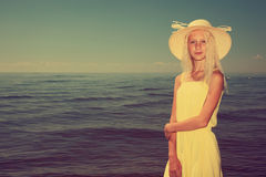 Girl with the sea on the background. Royalty Free Stock Photos