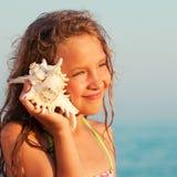 Girl on sea background stock photos