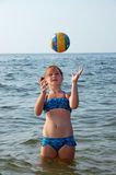 Girl, sea and ball Royalty Free Stock Photography