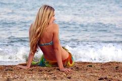 Girl on the sea beach. Ocean royalty free stock photo