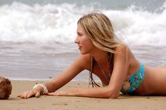 Girl on the sea beach Stock Image