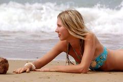 Girl on the sea beach. Ocean stock image