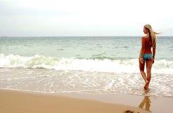 Girl on the sea beach. Ocean royalty free stock image