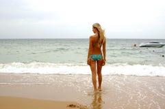 Girl on the sea beach. Ocean stock photo