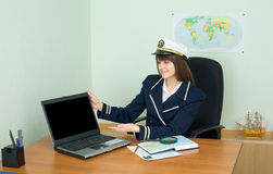 Girl - sea captain at office with laptop Royalty Free Stock Image