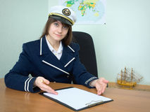 Girl - sea captain with the tablet Royalty Free Stock Photo