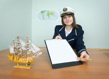 Girl - sea captain with a tablet and pen Stock Photos