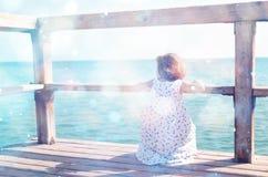 Girl at sea, defocused image Stock Image