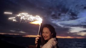 Girl on the sea with fireworks stock video footage